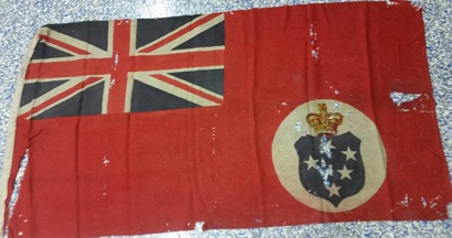 [Depiction of Victorian red ensign with blue disc]